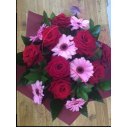 Red roses and Gerbera Aqua packed Bouquet